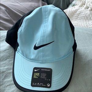 Nike light blue and black aerobill hat